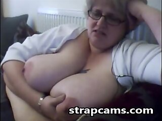 Granny with glasses plays with her enormeous tits