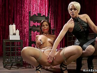 Busty brunette gets ankle suspension whipping