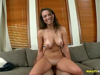 Busty and curvy Caucasian babe gets screwed on the couch