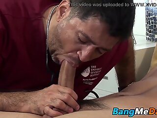 Handsome young man sexually treated by his lusty doctor