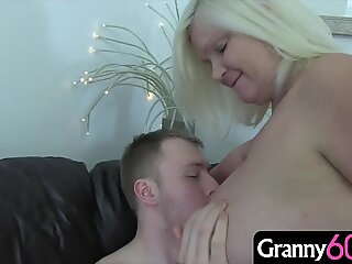 60 years-old wife with big tits has a hunger for cock that this young over is trying desperately to satisfy!