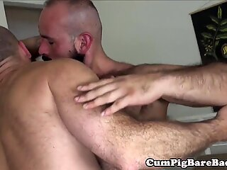 Hunky bear wanks cock while getting assfucked