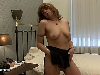 Tattooed granny Stacey loves to get herself wet and wild