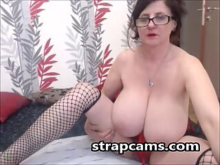 Charming granny with huge natural tits teasing on webcam