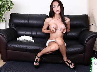 Raven haired ladyboy gets her tits out