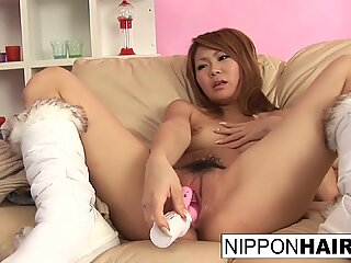 Japanese redhead puts all her favorite toys in her pussy