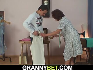 Old tailoress takes his cock from behind