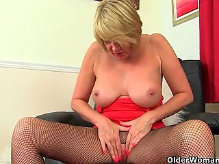 British milf Amy gets turned on in fishnet tights