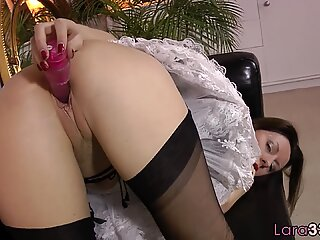 Alluring MILF toying her pussy in stockings