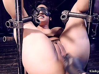 Busty Asian in stock gets toyed